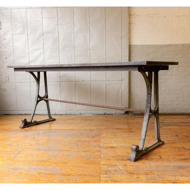 Large console or work table made from an industrial cast iron base with a marble top. Made in the early 20th century.
