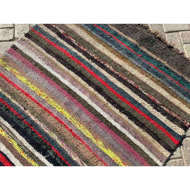 This beautiful, vintage, handwoven kilim is approximately 60 years old. It is handmade, of cotton. It has been...