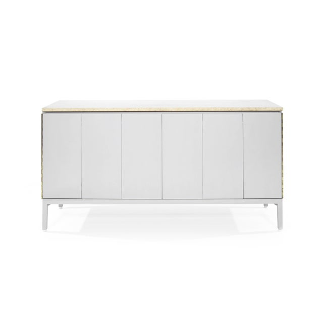 A dresser by iconic furniture designer Paul McCobb. Exquisitely redone in light grey, this dresser features tri-fold doors...