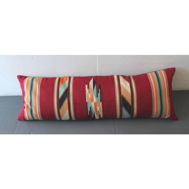This is a very punchy and graphic geometric bolster pillow. The colors are most unusual.The backing is in black cotton...