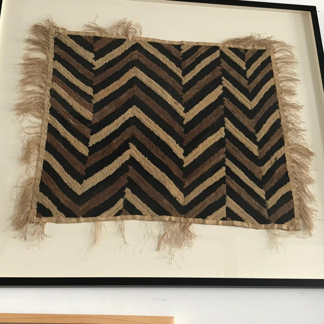 Hand made antique zig-zag pattern tapestry from the Congo is made from raffia cloth and has a pile center. Newly re-framed.
