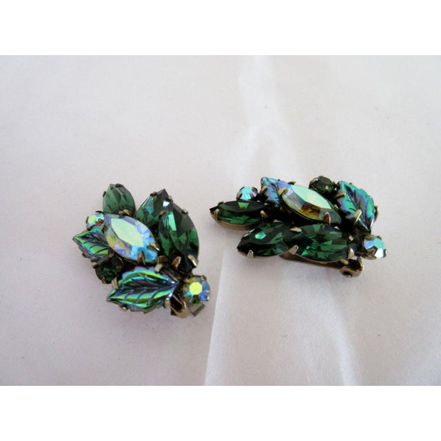 """Pair of Regency clip earrings with a leaf motif. Dimensions: .75"""" wide x 1.5"""" high Due to the unique nature of this..."""