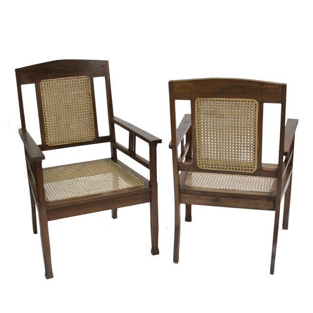 A pair of classy British Colonial chairs with delicate lines and cane seating & back. These chairs are the perfect accent...
