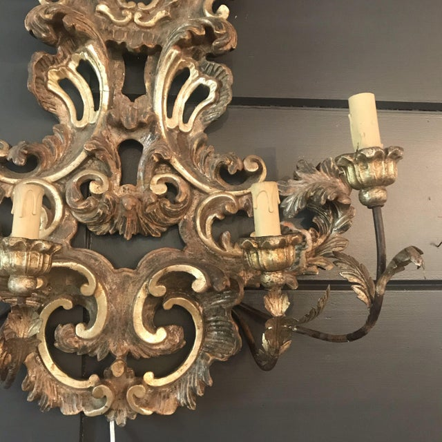 A beautiful large (over two feet tall) Rococo style painted and carved wooden and metal four-light sconce with floral...