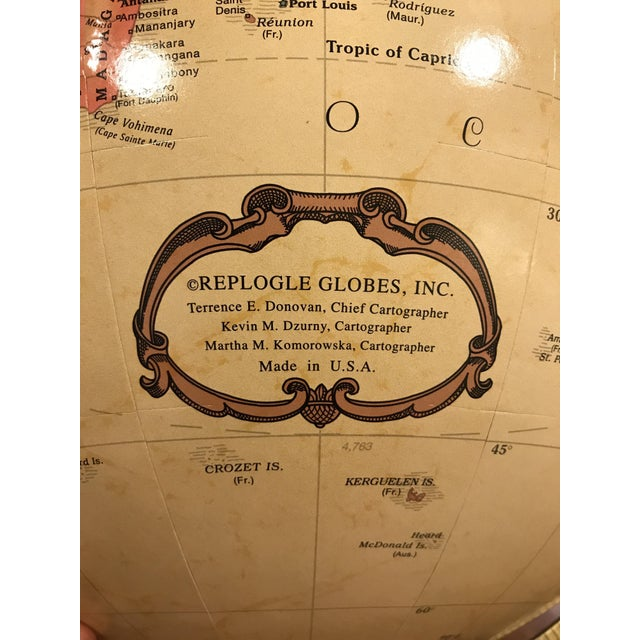 """Sophisticated and Worldly Replogle Globe. 42"""" tall x 22 wide. Globe itself is 16"""" across. Globe spins around in a..."""