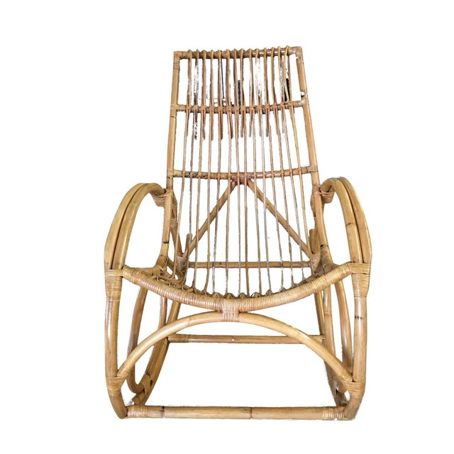 Rare oversized Franco Albini-style two-strand round arm stick rattan rocking chair. This rare pretzel rocking chair was...