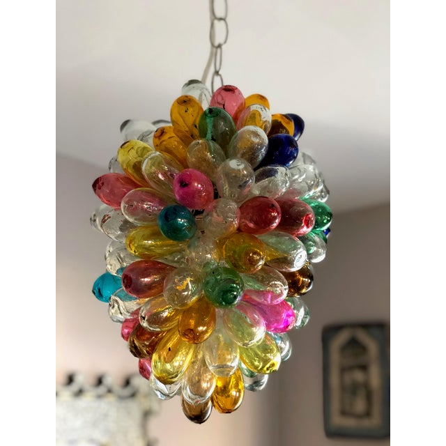 This fun colorful sculptural light fixture is composed of individual hand blown balloon shaped pieces, individually...