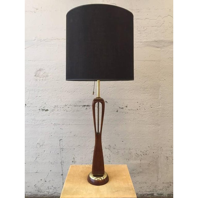 """Sculptural walnut and brass lamps by Gerald Thurston for Lightolier. Measures: 43"""" H (to top of finial). Under socket..."""