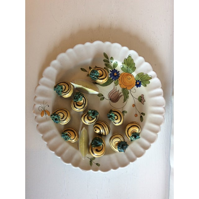"""Decorative Art Wall Plate with escargot and lemon wedge. Made in Italy. 10""""dia. Trompe l'oeil. The stand is not included."""