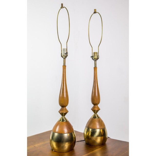 Pair of table lamps by Tony Paul in brass and walnut.