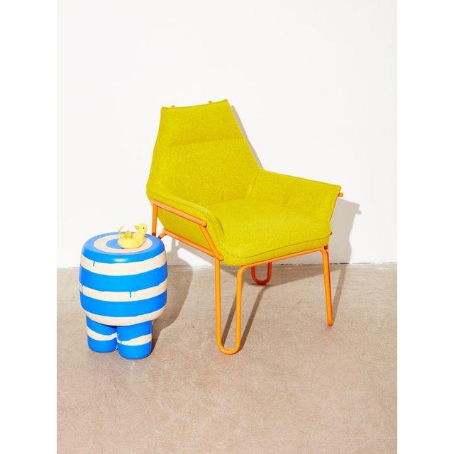 Designed by New York based Tom Hancocks. Powder coated steel frame and upholstered seat.