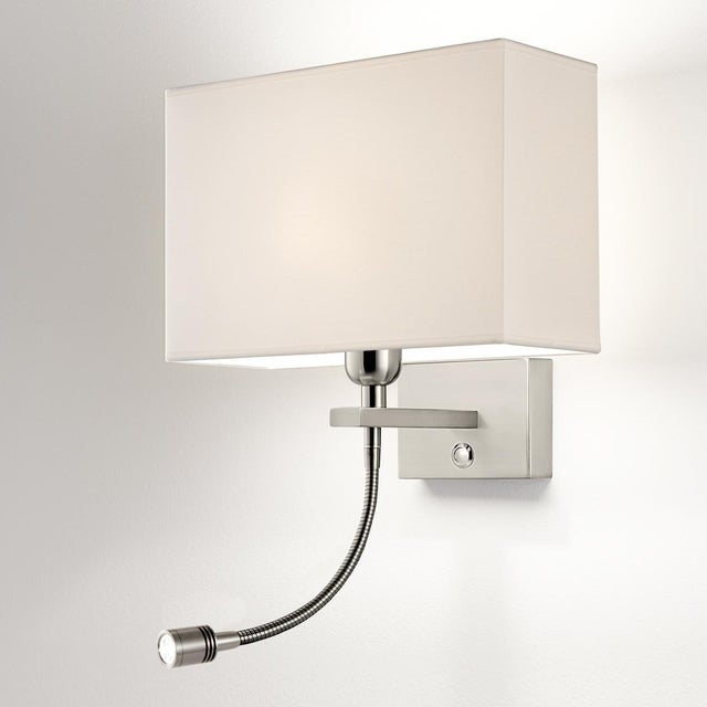 A brushed nickel combination wall light with backplate housing a LED reading light with grooved cylindrical head, robust...