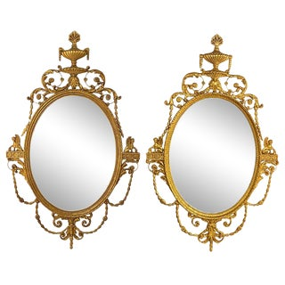 Pair of Freidman Brothers Compatible Sphinx Gilt Gold Beveled Oval Wall Mirrors For Sale