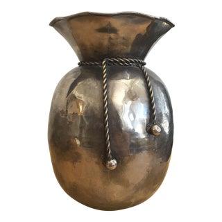 Hammered Metal Sack Vase With Tassels For Sale