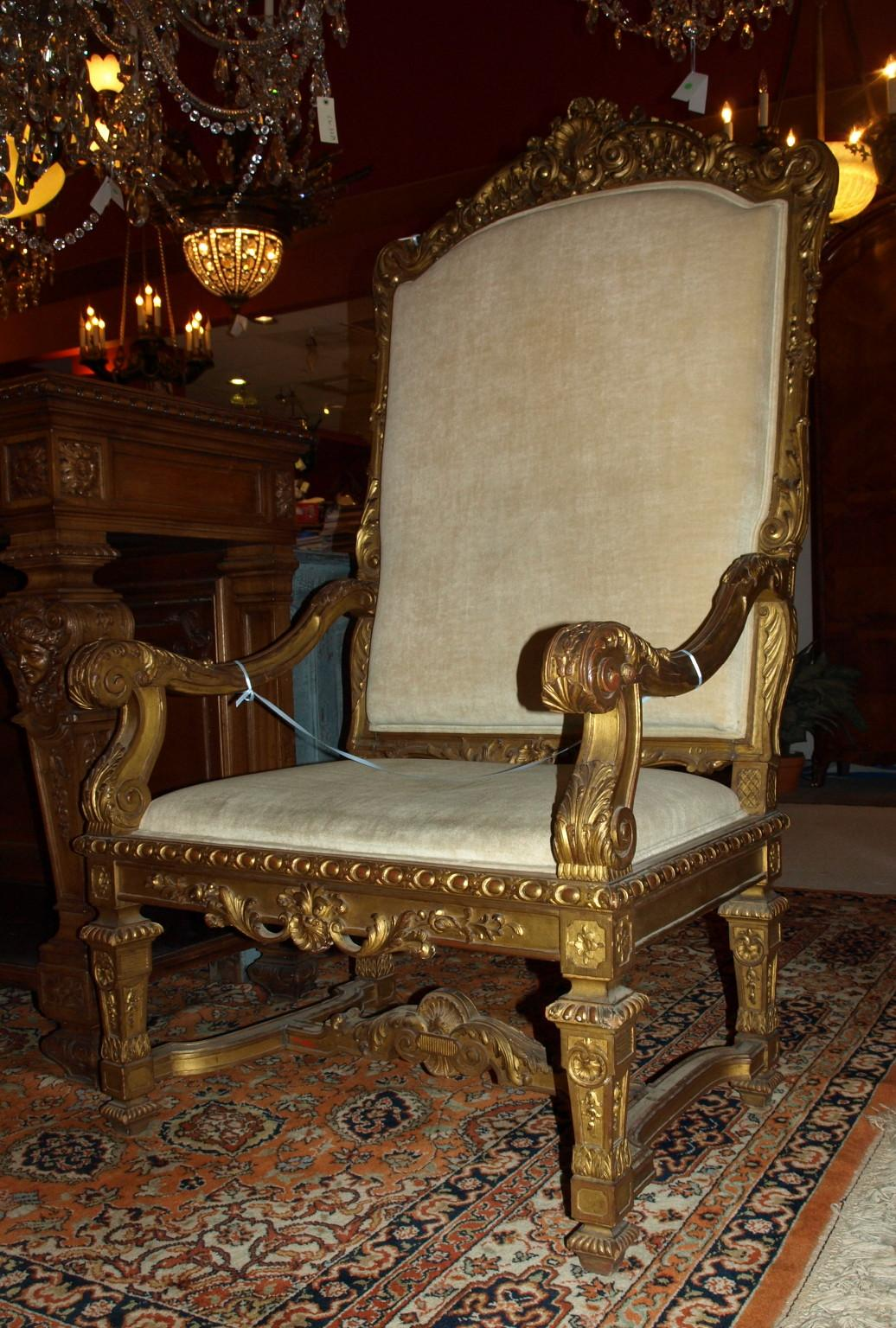 A Large Armchair Profusely Carved With Pierced Shell And Floral Garland  Cresting, 24 Carat Gold