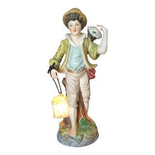 Vintage Boy Holding Light Lantern Figurine For Sale