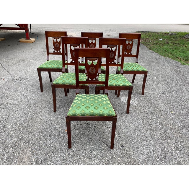 Fine Set of six French Empire dining chairs solid mahogany with green color silk, the chair Mahogany frames are in...