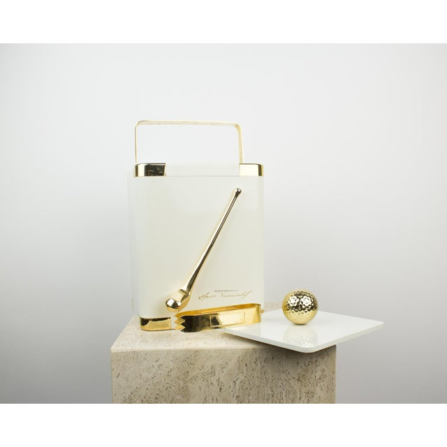 Vintage ice bucket designed by Hans Turnwald for The Turnwald Collection. Eggshell white color with 24K gold painted...