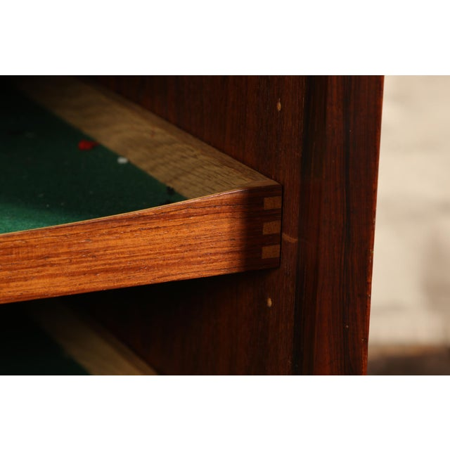 Circa 1960's. Finely crafted with the banded top forming a recessed front with double sliding doors with raised wood...