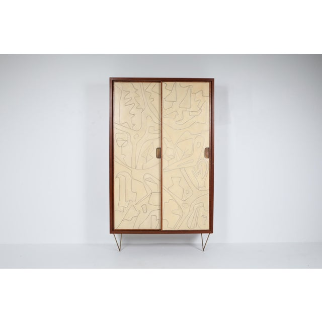 Victor Cerrato, cabinet, wood and brass, Italy, circa 1958. This masterpiece is pure art, amongst our favorite pieces as...