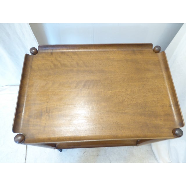 """20th Century modern tray table by John Stuart, with his label on the inner apron, table disassembles and folds up, 16""""..."""