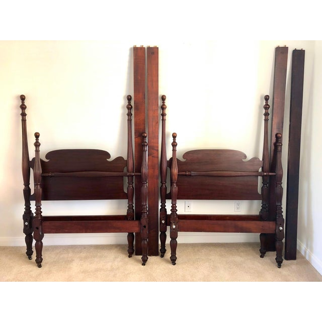 These early 20th-century set of mahogany Federal style carved twin beds are the perfect addition to any room! Excellent in...