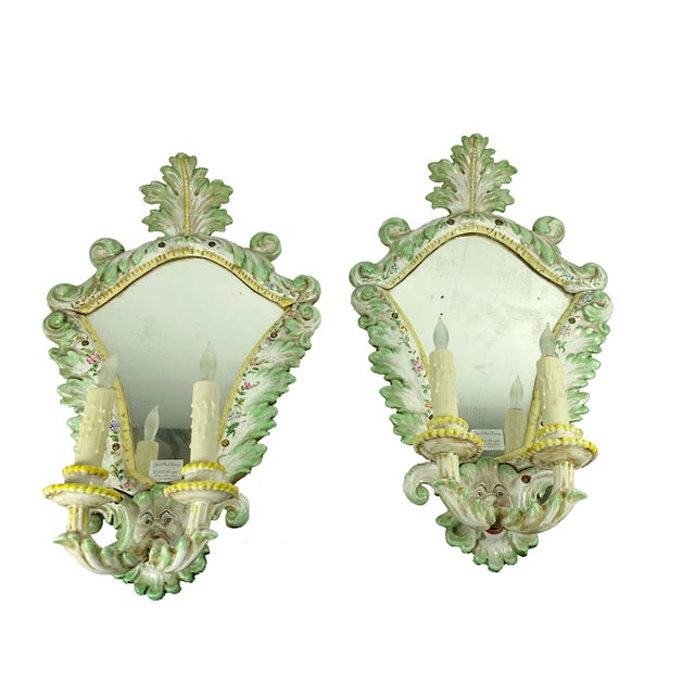 "A pair of 19th century Italian porcelain sconces with faces and two lights. Green and Yellow Trim 14' Wide x 6"" Deep x 24""..."