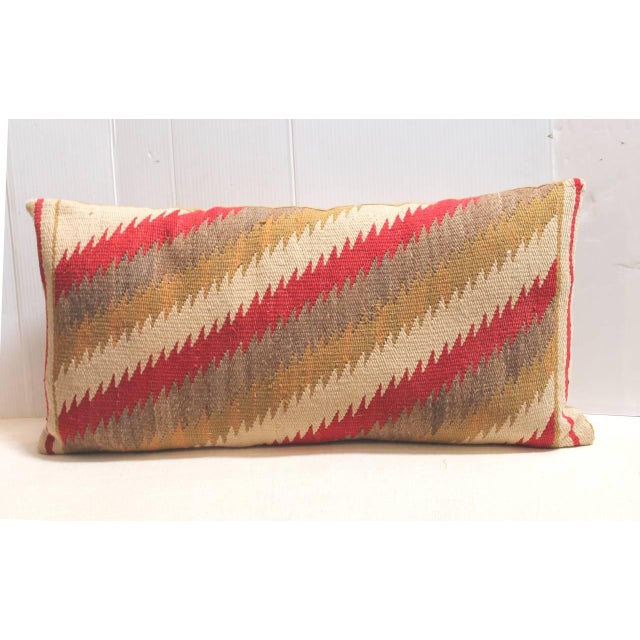 This early geometric Navajo weaving pillow has a wonderful jagged edge pattern almost like feather edge streak of...