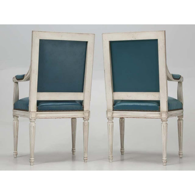 Louis XVI style Dining chairs upholstered in Blue leather with White painted frames.