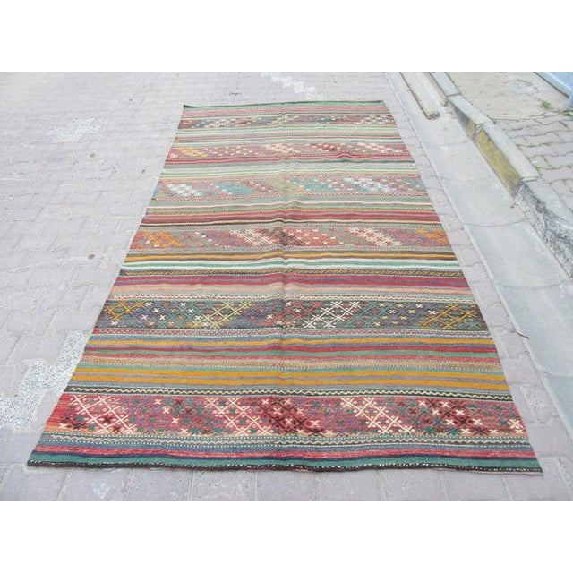 Handwoven Vintage Kilim rug from Denizli region of Turkey. Approximately 45-55 years old.In very good condition.