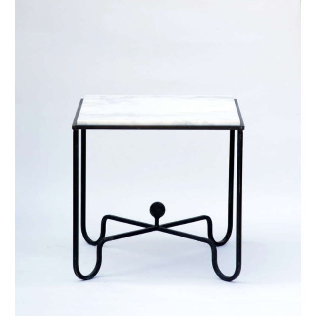 """The """"Entretoise"""" Wrought Iron and Marble Tables. Blackened wrought iron bases with honed (matte finish)Carrara marble tops."""