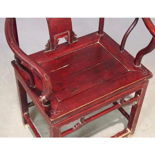 Lacquered in transparent cinnabar-red, this square-back guanmaoyi, or official's hat chair, dates from the end of the Qing...