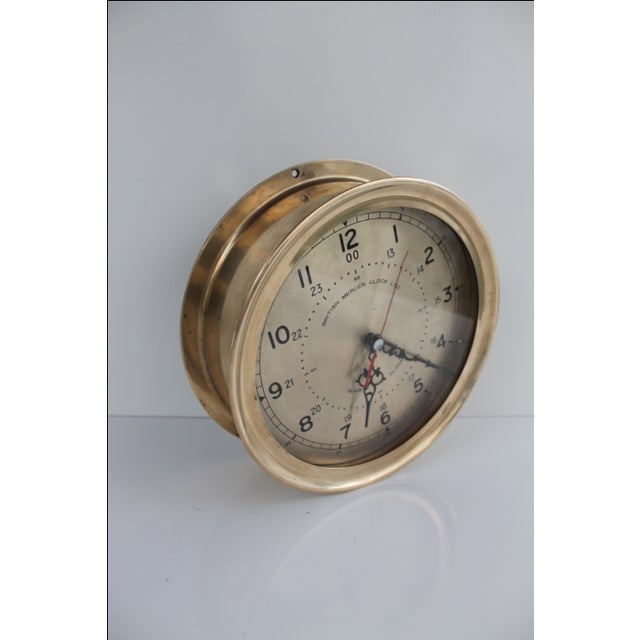 Vintage Nautical British Mercer Clock LTD 1940s. This thick and heavy wall clock is made of solid brass and features...
