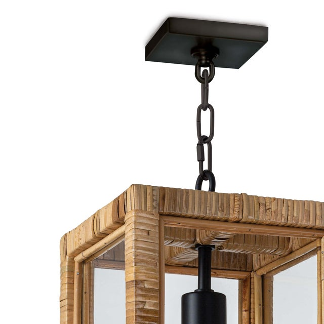 A bamboo-wrapped frame around four clear glass panes showcases whatever bulb you choose for the Newport lantern. The...