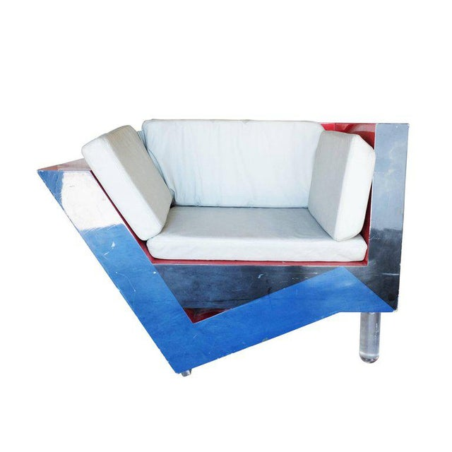 Memphis inspired asymmetric sculptural lounge chair with unique tri-color design and acrylic legs designed and...