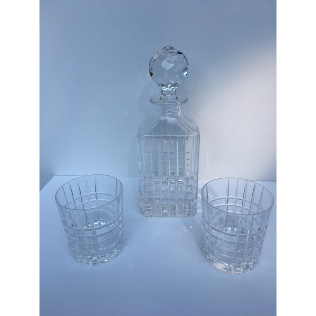 """Elegant, traditional Tiffany """"Plaid"""" decanter and two double old fashion glasses. Still active today, the bold symmetry of..."""