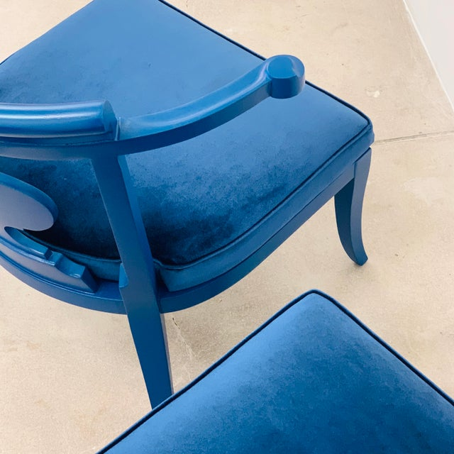 These vintage 1950s Chinoiserie style horseshoe chairs have been redefined in Bold Klein Blue by Reitter Design Studio....