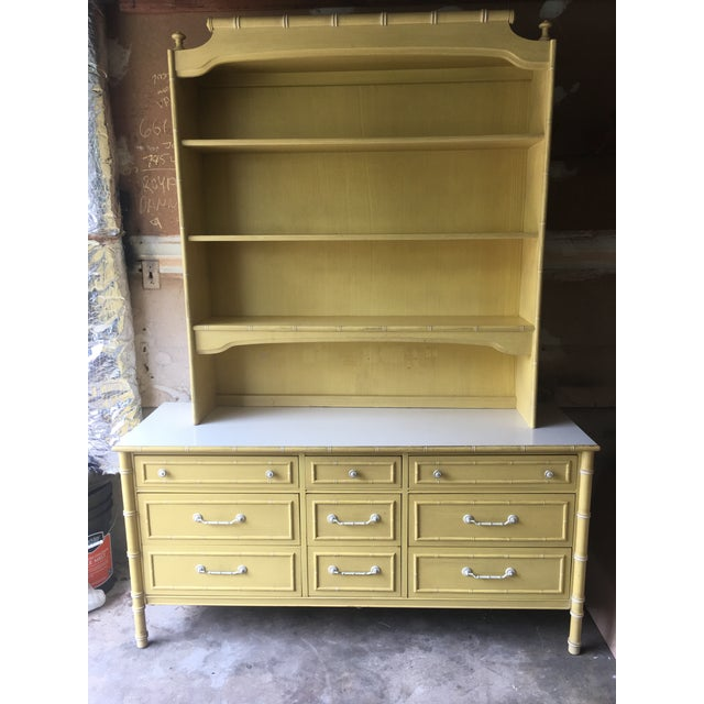 Beautiful faux bamboo yellow triple dresser with hutch. This piece is Thomasville and made in the 1970s. The faux bamboo...
