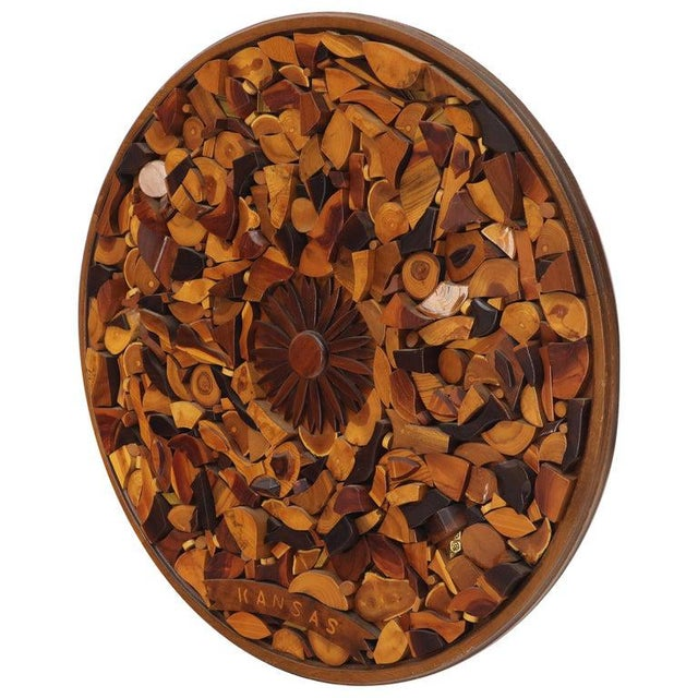 Large Mid-Century Modern round wall sculpture wood pieces collage with sunburst rosette in the center.