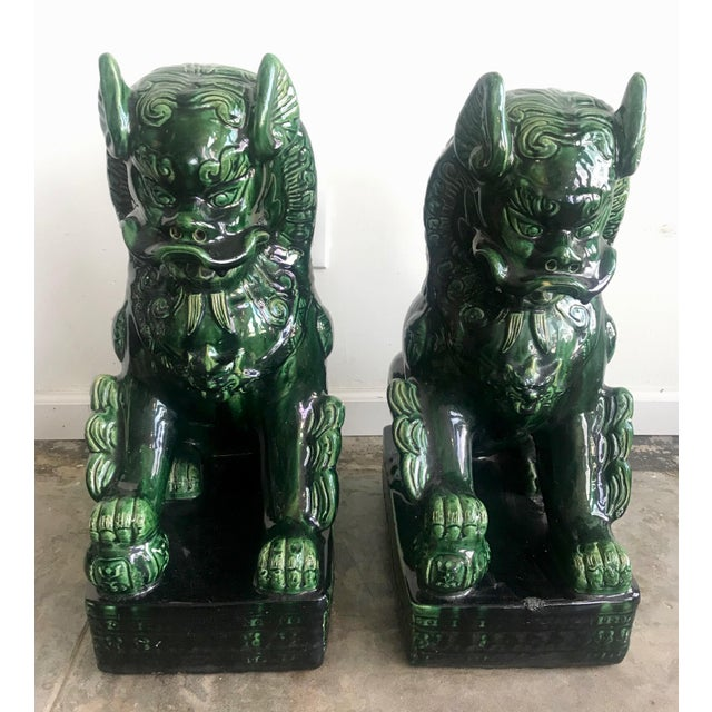 Gorgeous pair of vintage emerald green glazed porcelain garden Foo Dog statues. Perfect for inside or outside. Circa...