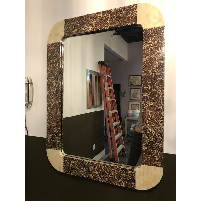 This 1980s Hollywood Regency style mirror is made of tessellated bone and coconut shells.