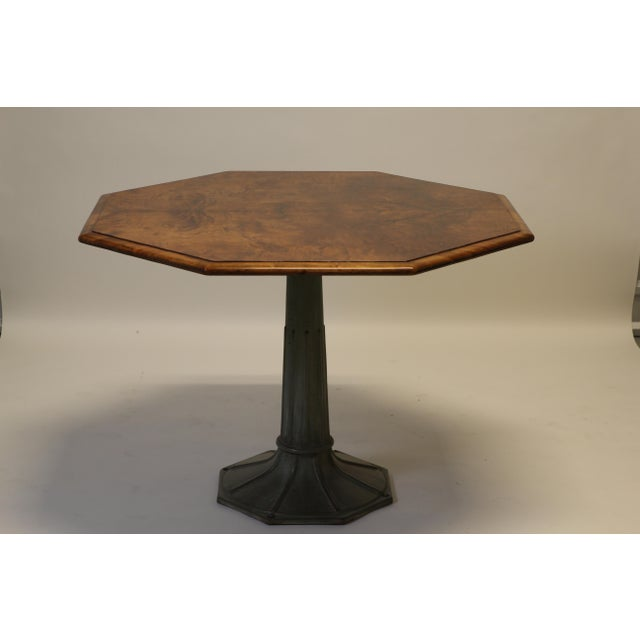 A beautiful antique hexagonal crotch mahogany table sits atop a patinated fluted metal base. Top has been recently...