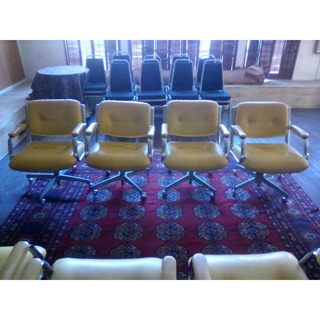 Heavy duty commercial faux leather yellow upholstery Captain chairs set . They have Chrome on arms and bottom there heavy...
