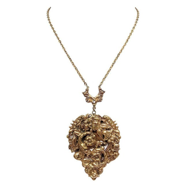 c.1930s goldtone metal pendant necklace with an ornate floral design. A lovely piece that would look great with a vintage...