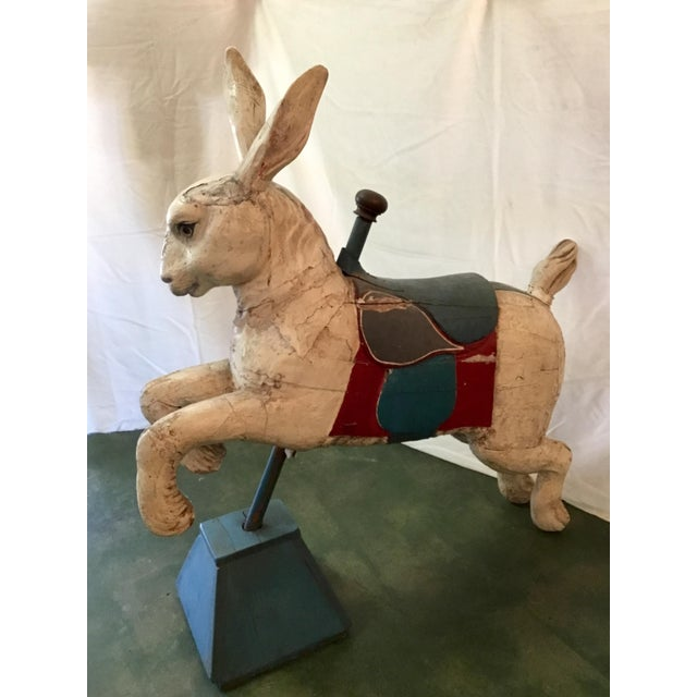 This pleasing Juvenile Carousel Rabbit is captured mid leap and mounted on a wooden base. Hand carved and painted with...