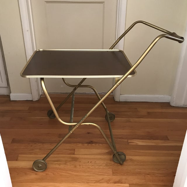 Did someone order room service? This vintage mid-century rolling bar cart or serving tray is the perfect accessory for...