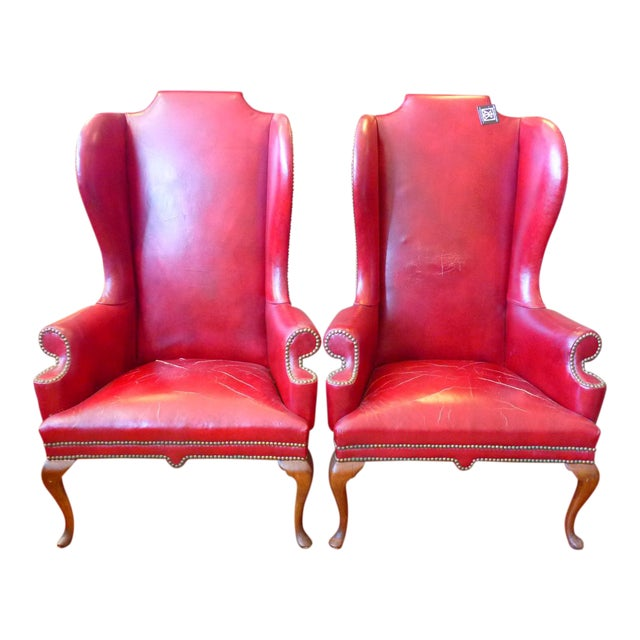 Vintage Red Leather Wingback Chairs With Nailhead Detail and Generous Proportions- Pair For Sale