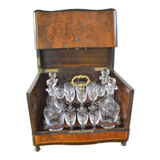 19th Century Portable Bar With the Origianal Etched Crystals Decanters and 14 Sherry Glasses Sitting in a Rosewood Box. For Sale