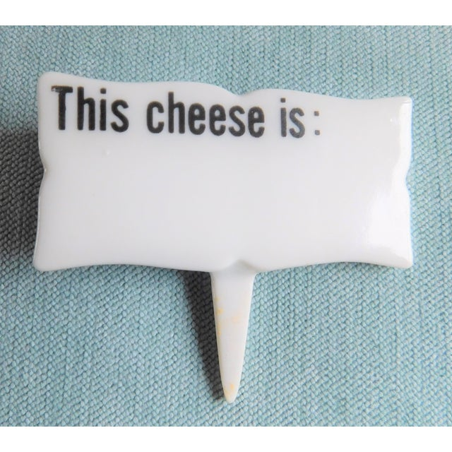 "This charming mid-century set of six white and black porcelain ""This Cheese Is"" cheese markers is perfect for your next..."
