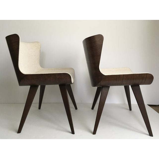 Fabulous combination of details on these handsome chairs. Comes with felt floor protectors for the legs.